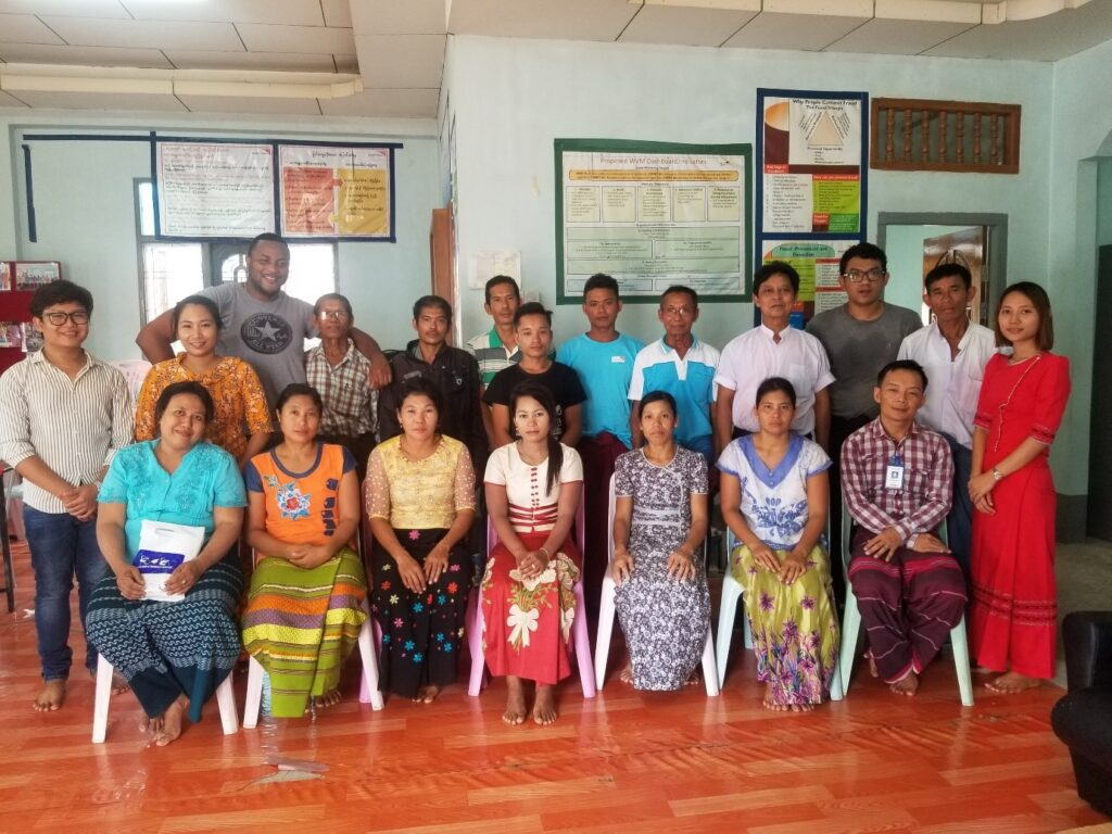 Image shows researcher with participants in Myeik in June 2019
